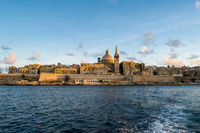 Panoramic view of Valletta Skyline at beautiful sunset from Sliema