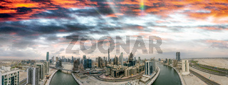 Downtown Dubai at sunset, UAE. Amazing aerial view from drone