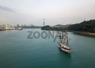 Aerial view of a sailing boat entering Keppel Bay, Singapore