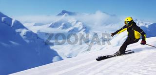 Skier in winter mountains