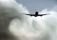 The turbulence of the clouds left by the plane during