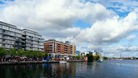 Festival at Dublin Docklands. River Liffey with modern buildings on the banks.