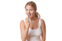 Attractive woman practicing dental hygiene