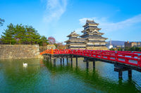 View of Matsumoto Castle with red bridge in Nagano, Japan
