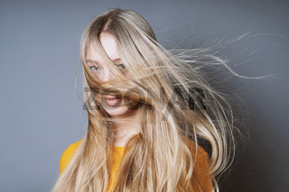 blond woman with long windswept tousled hair