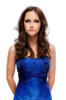 Portrait of young beautiful woman with dark hair in blue dress
