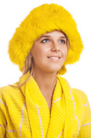 Beautiful smiling young woman in yellow fur hat