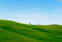 Beautiful spring minimalistic landscape with green hills in Tuscany