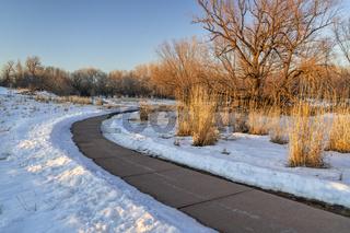 windy bike trail in winter scenery