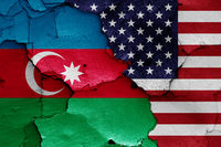 flags of Azerbaijan and USA painted on cracked wall