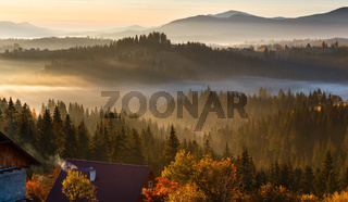 First sunrise rays of sun in Carpathian mountains.
