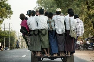 Overcrowded pickup truck on a highway in Yangon.  February 23, 2014 - Rangoon, Myanmar