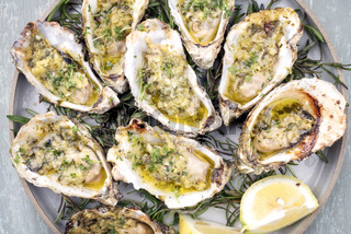 Barbecue overbaked fresh opened oyster with garlic