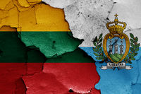flags of Lithuania and San Marino painted on cracked wall