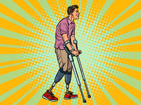 legless veteran with a bionic prosthesis with crutches. a disabled man learns to walk after an injury. rehabilitation treatment and recovery