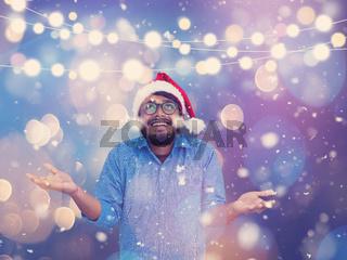 Indian man wearing traditional Santa Claus hat