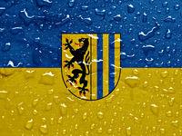 flag of Leipzig with rain drops