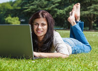 Woman with laptop in summer park