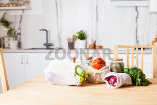 Kitchen interiour and table with groceries in textile bags