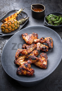 Exotically barbecue chicken wings with hot chili sauce