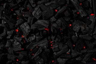Charcoal background illuminated with red light underneath
