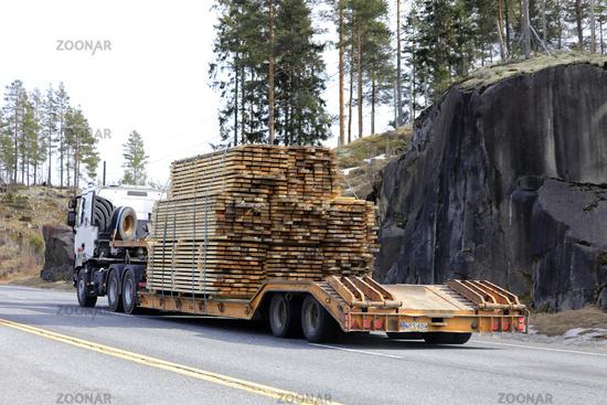 Truck Hauls Lumber on Trailer