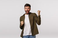 Relish, celebration and victory concept. Cheerful triumphing lucky businessman, guy winning, achieve prize or goal, have great news, fist pump and smiling, become champion, white background