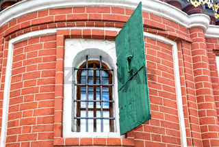 Old brick wall with an old window of Saint Basil's (Pokrovsky) Cathedral