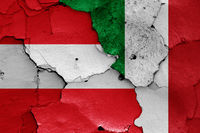 flags of Austria and Italy painted on cracked wall