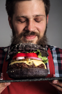 Man enjoy smelling burger