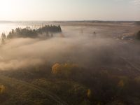 Top view of countryside in early foggy morning in Russia