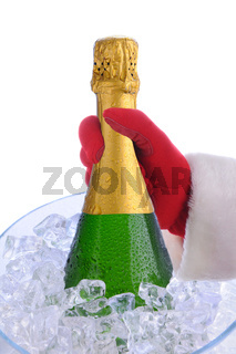 Closeup of a Santa Claus hand taking a Champagne bottle from a crystal ice bucket
