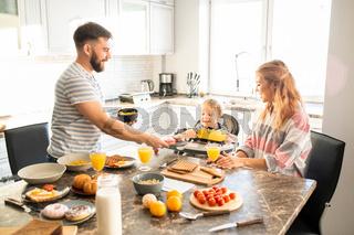 Happy Family Enjoying Breakfast in Morning