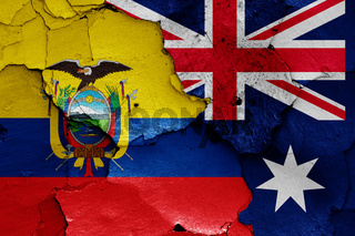 flags of Ecuador and Australia painted on cracked wall