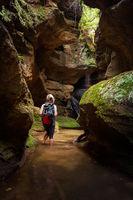 Tourist or female adventurer exploring a canyon