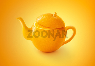 Teapot of Orange fruit isolated on orange color background. Concept of  juice with fresh fruits .