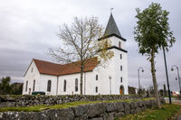 Farsund, Norway - October 2019: Vanse Kirke, an old white stone church from 1037.