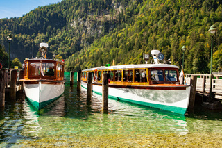 Electric tourist boats on beautiful lake Konigssee pier Berchtesgaden National Park Bavaria Germany