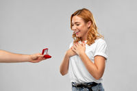 man giving woman engagement ring on valentines day