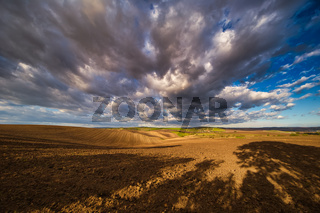 Autumn field with clouds