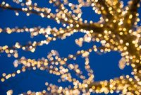 Blurred golden lights on Christmas Tree