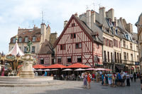 many tourists visiting the Francois Rude Square in the historic old city center of Dijon