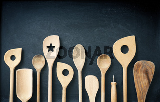 Wooden kitchen tools on a chalkboard