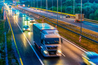 Trucks on four lane controlled-access highway in Poland.