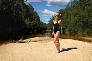 Aussie woman in bikini  in bushland river bank