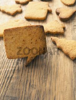 Tasty Christmas cookies on wood