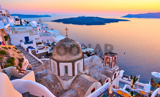 Aegean sea and Thira town at sundown