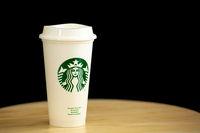 Starbucks coffee cup on table