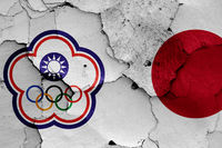flags of Chinese Taipei and Japan painted on cracked wall