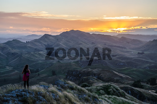 Sunset view with hiking girl at Te Mata Peak near Hastings in Hawkes Bay on North Island, New Zealand